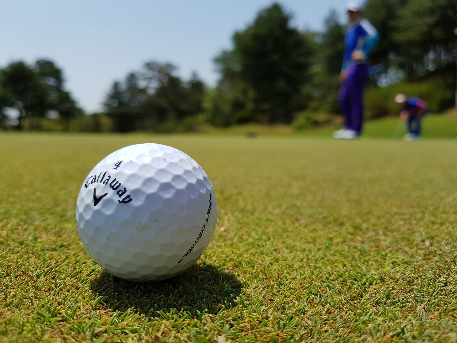 A man playing golf.