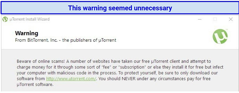 Screenshot of a warning from uTorrent about scammers selling the free version of the program
